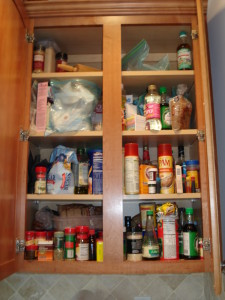 Evelyn H. Cluttered Kitchen Cabinet Before 2